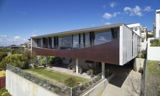 this-house-is-conceived-as-a-suspended-belvedere-maximising-views-solar-aspect-and-privacy.-511x307
